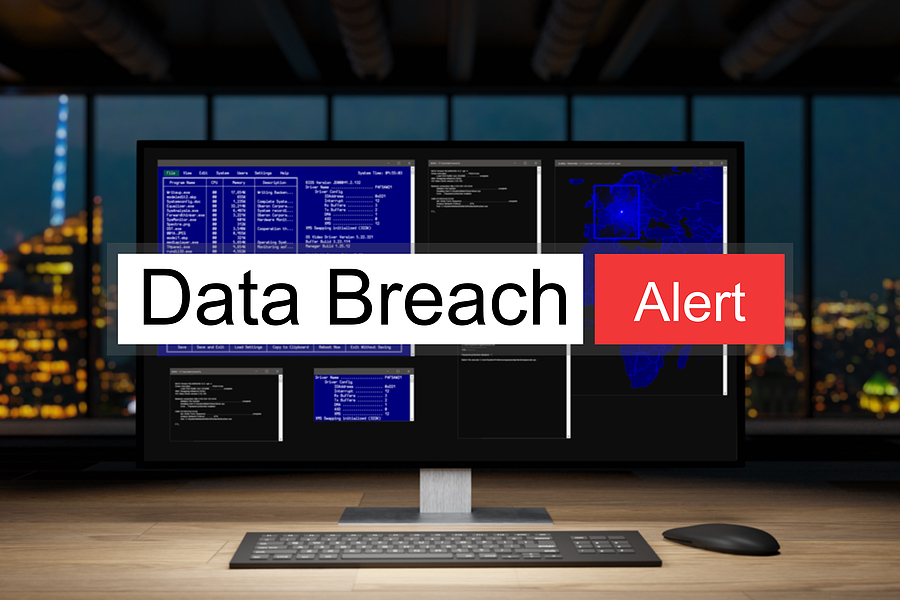 Data Breach Alert notification in front of a desktop computer.